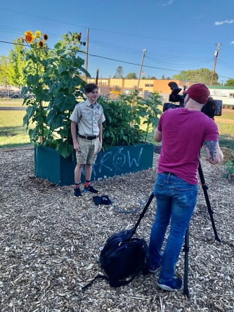 """Eagle Scout candidate """"Nick"""" explaining the project for local news"""
